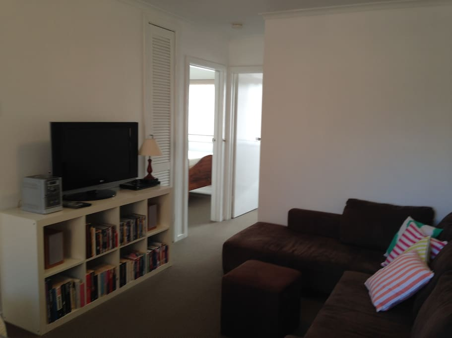 Lounge room with large flat screen, DVD player and plenty of DVD's and books for guests