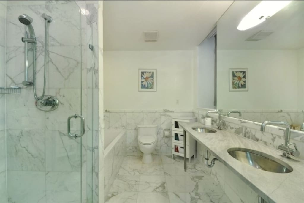 Marble bathroom with his and hers sinks.