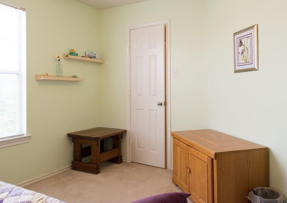 Other side of the bedroom - closet pictured. Cabinet also empty for suitcase storage if desired