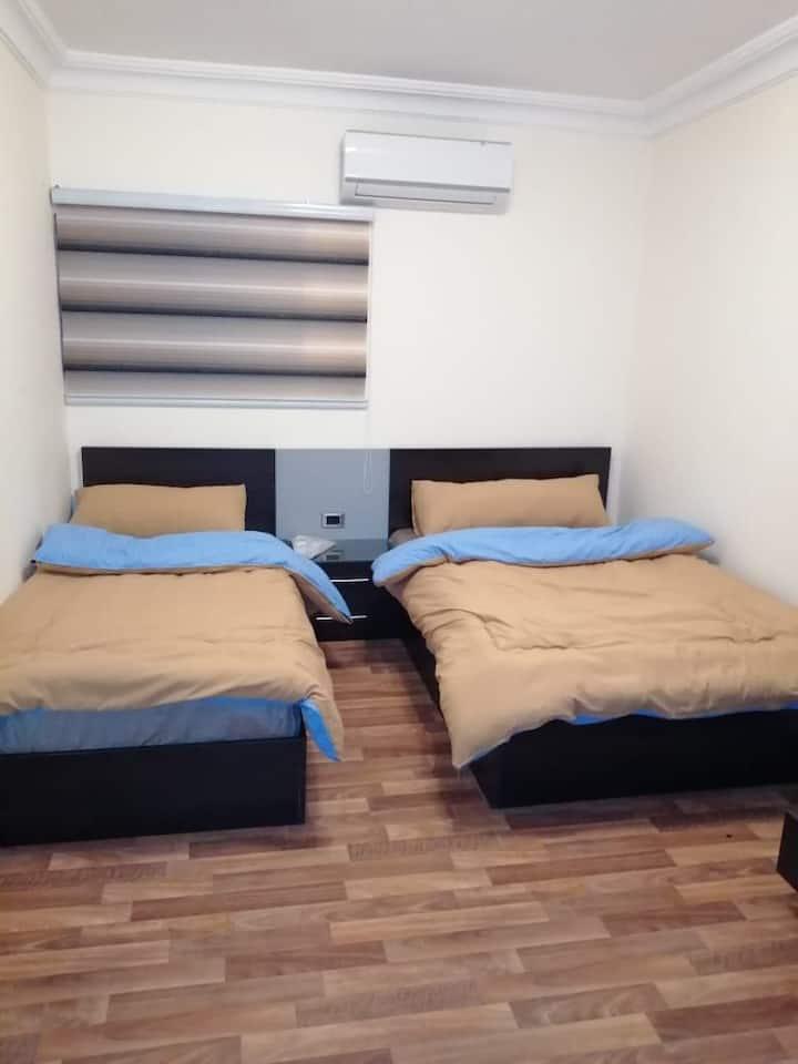 Rayyan Hills apartment, twin bedroom, queen & SML