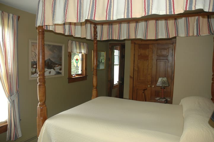 Another view of the bedroom area. It is taken from the bedroom area looking in the direction of the private bath.