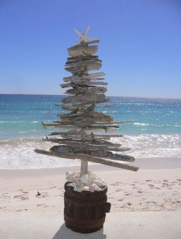 Christmas at the beach. Tree made of driftwood