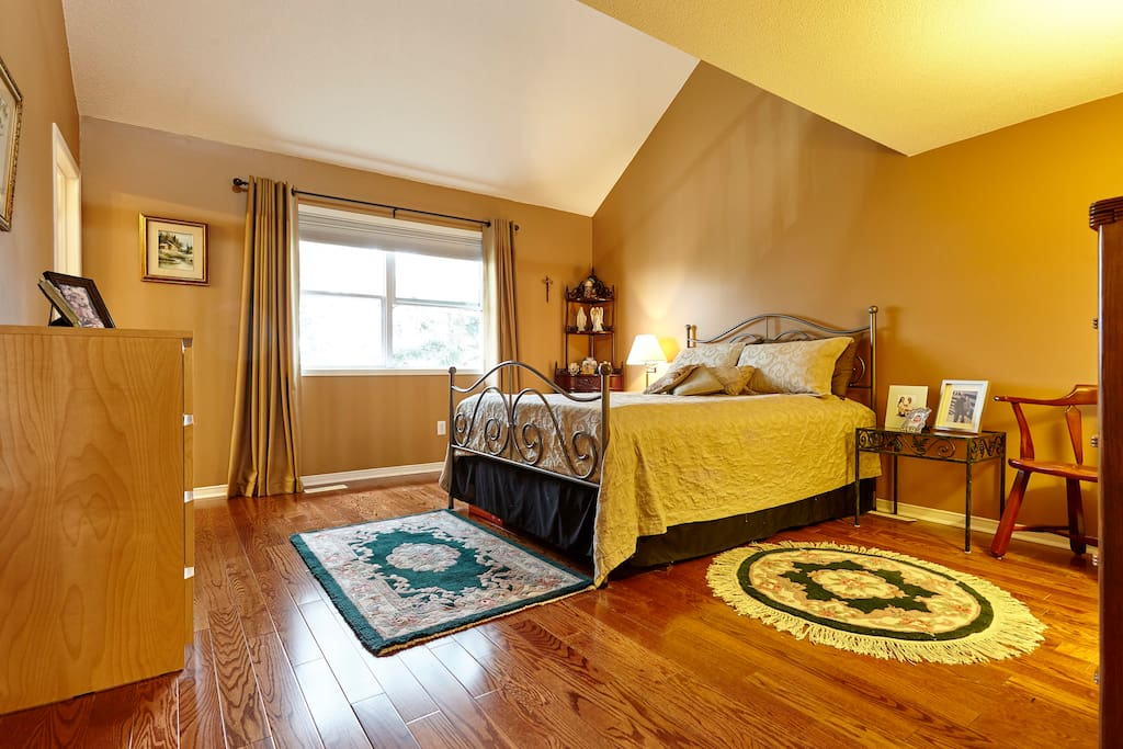 Large and private Master bedroom with loft, attached bathroom and high cathedral ceiling.
