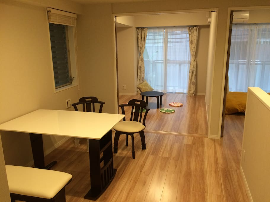 Dining table with 2 bed rooms (one is fixed bed room, the other can be a bed room with sliding door) Now, we have a luxury L style sofa in dining room and one western style double bed.