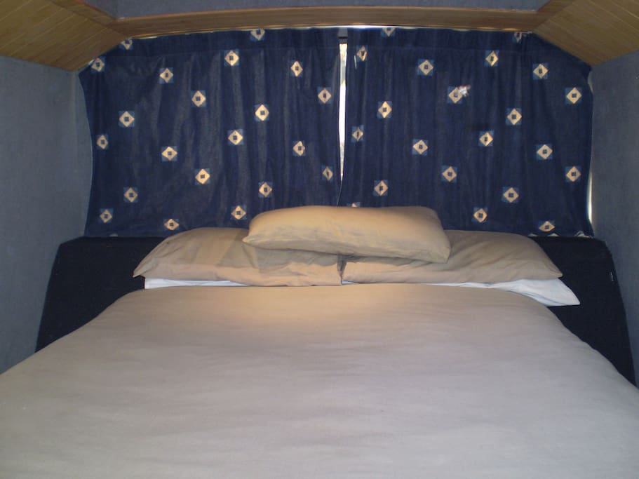 Comfortable double bed awaiting after a day exploring.