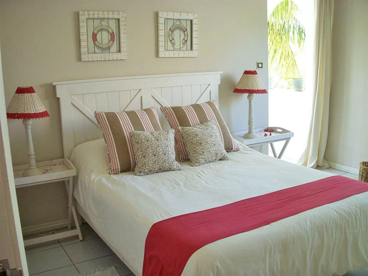Double Bedroom with access to balcony, ample storage space, a desk and a small safe