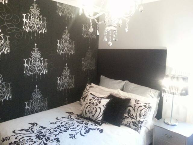 French Provincial bedroom with double bed in elegant silver and grey tones