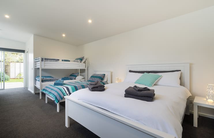Bungalow with queen, bunk and single (Additional $100 per night)
