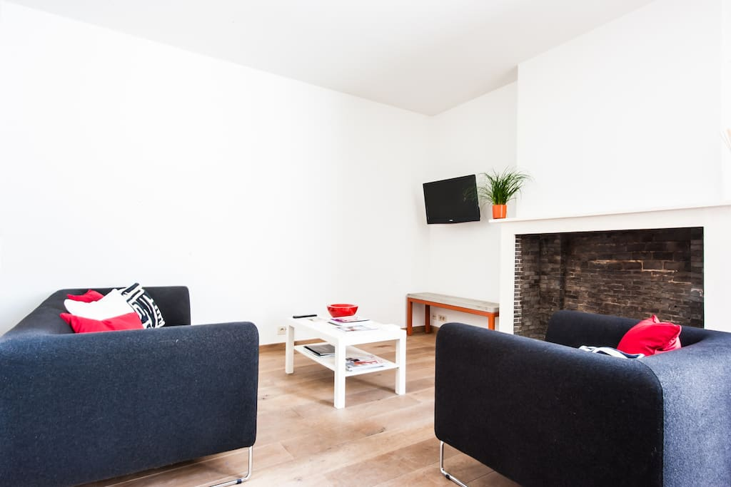 The living room with oak flooring and cable LED tv