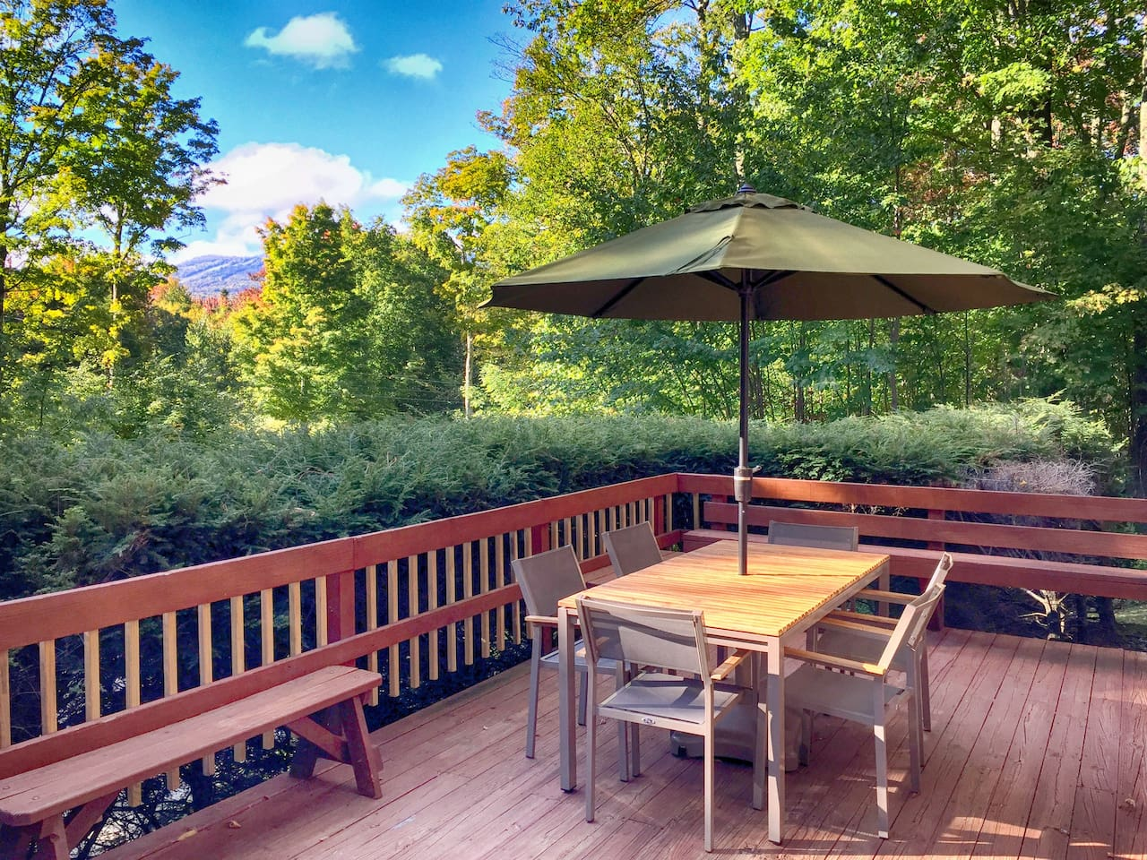 Front deck with table, chairs, umbrella and great views.