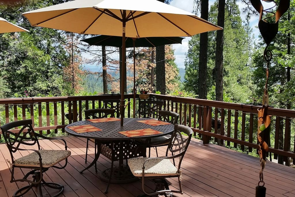 Large wood deck with plenty of outdoor seating.  Beautiful, sweeping views of the surrounding hills.