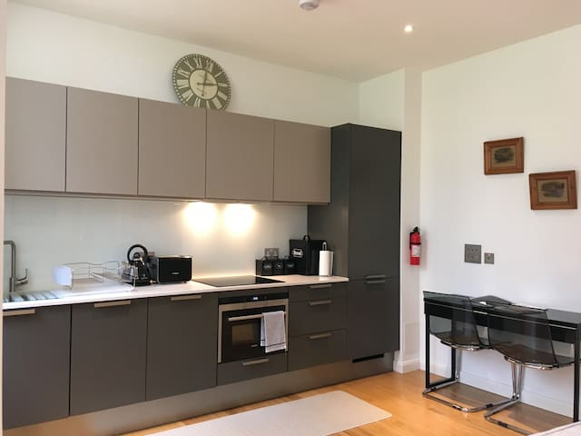 Our fully equipped kitchen with desk / dining table for 2.