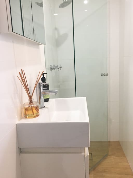 Private, newly renovated bathroom with glass shower, vanity and toilet