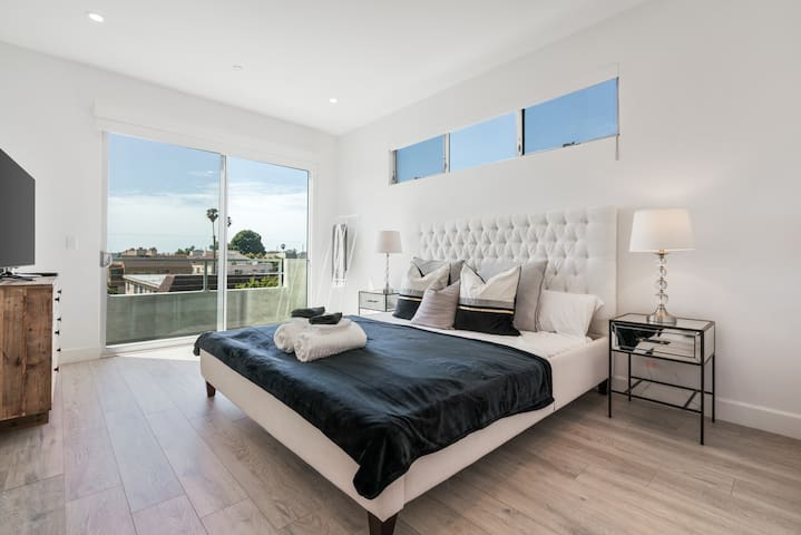 Level 3 - first master bedroom with California king bed and a large balcony.