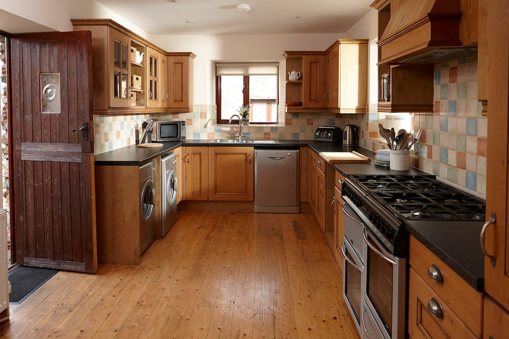 Kitchen with double oven, washing machine, tumble dryer, dishwasher, fridge/freezer & Tassimo coffee machine