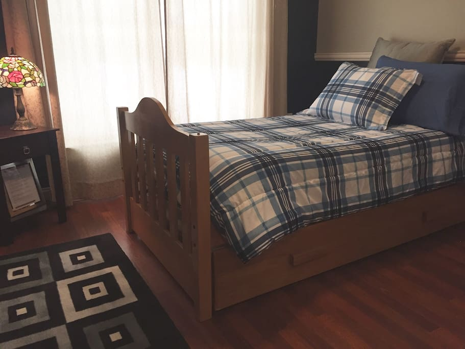 This clever bed easily accommodates one or two people thanks to the trundle that is tucked beneath.