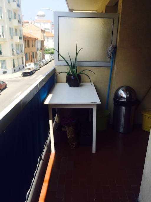 Spacious balcony with two tables