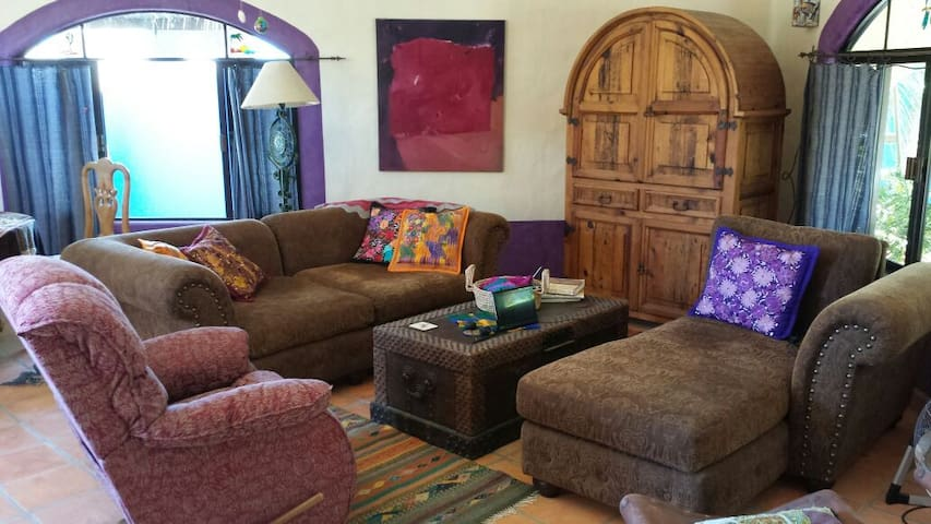 DVD/TV and comfy sofas and LazyBoy recliner