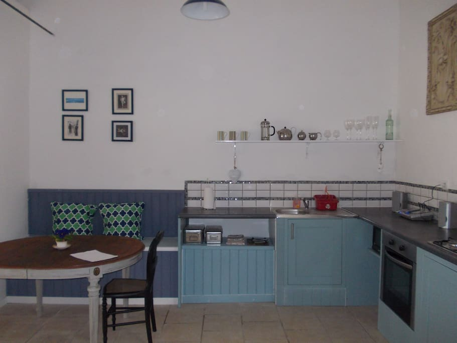Well equipped kitchen with dining table and chairs