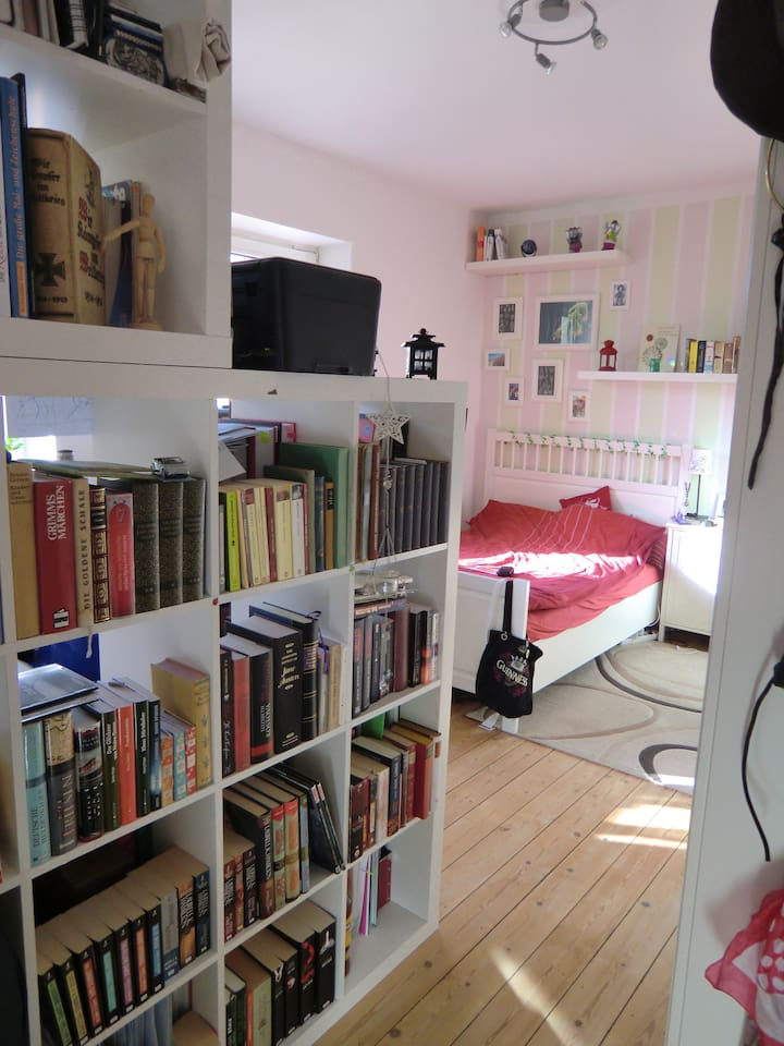 My room looking from the door to our common room. Wardrobe on the right and some book shelves ;-)