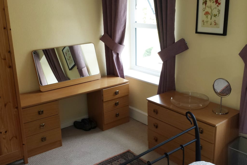 There's a wardrobe and plenty of drawers for storage in the front bedroom