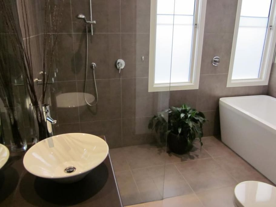 Use of modern bathroom with separate bath
