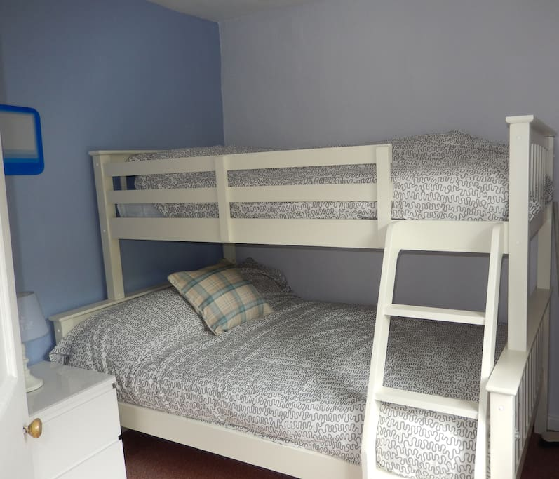 There's a double bed and a single bunk bed in the back bedroom