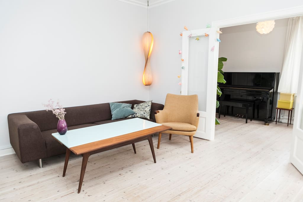 The living room. You will be surrounded by classic furniture of the famous danish architects.