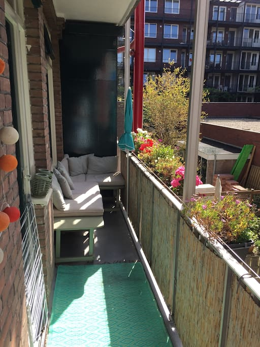 sunny balcony with couch