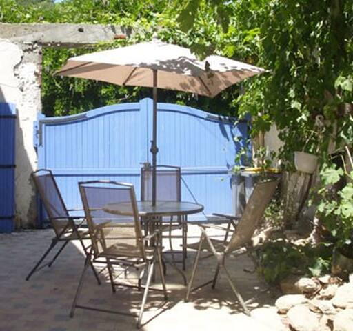 Courtyard shared with owners house, with vines giving shade in summer