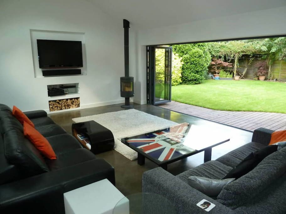 Huge family area with concrete floor and bi-fold doors