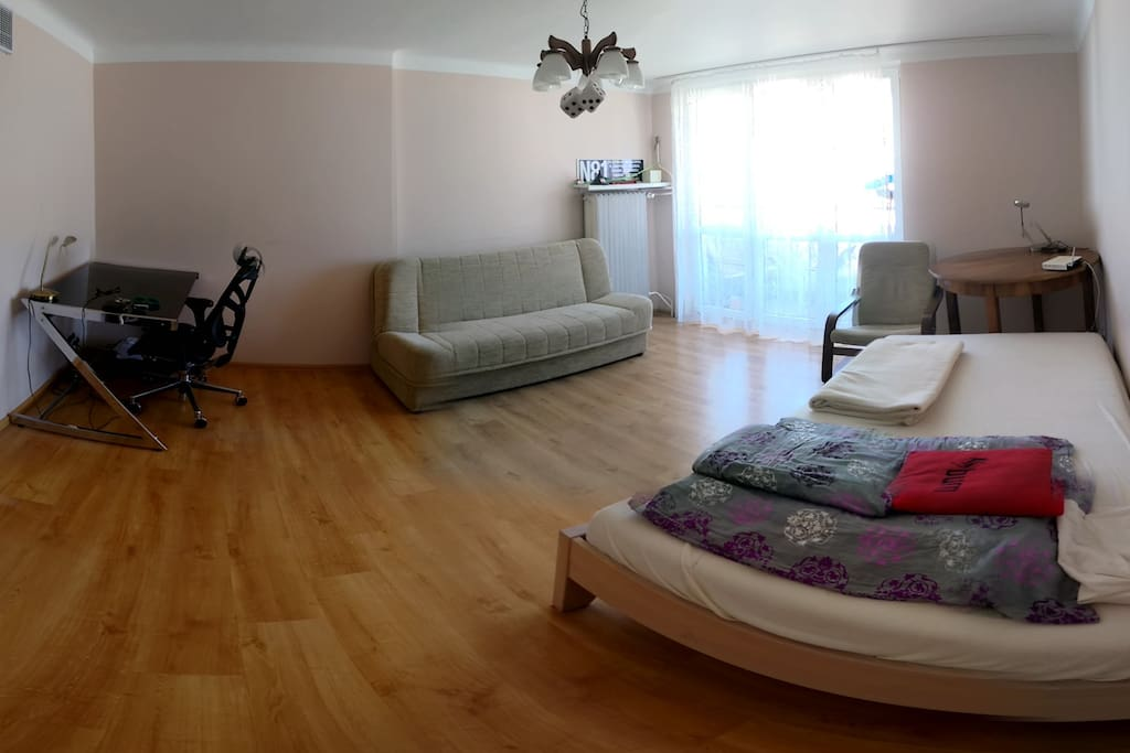 the 2nd room: double bed, sofa, table, desk, balcony