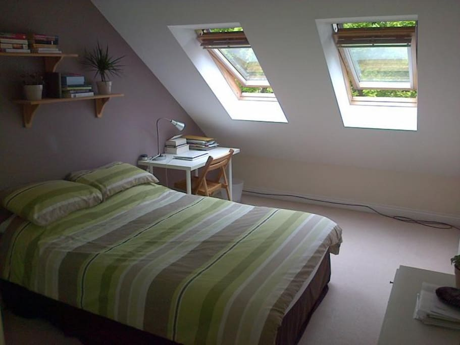 Your spacious room with blinds for a great nights sleep