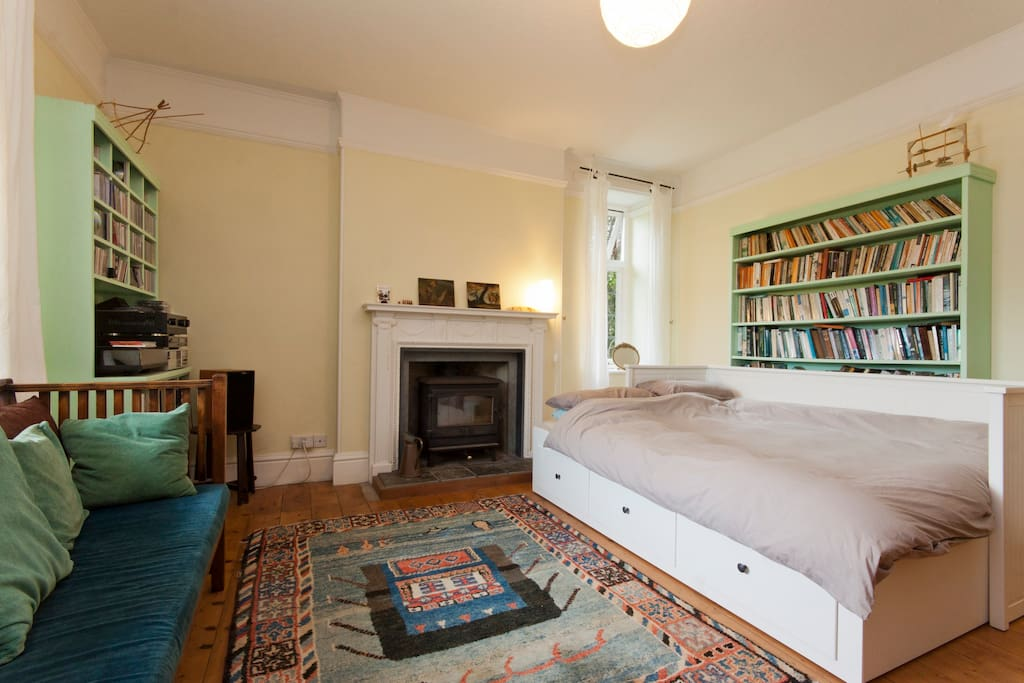 Very comfy room with big sofa bed, arts & crafts sofa, books and hifi.