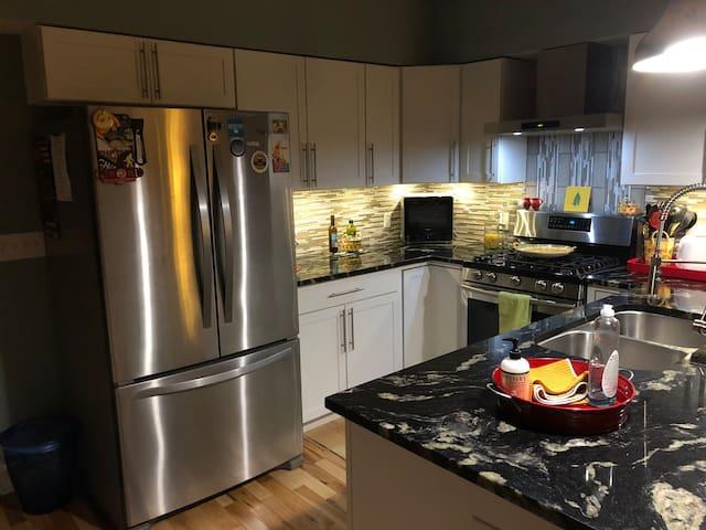 Kitchen w/ Stainless Steel Appliances.