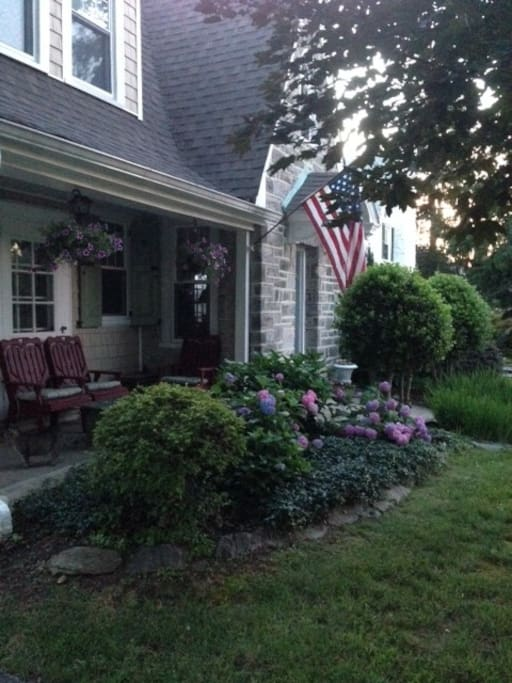 cottage charm with lovely hydrangeas and front porch
