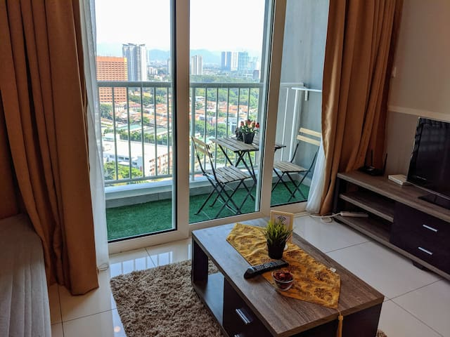 Living room with balcony overlooking an amazing view. This unit is on high floor so it is very breezy