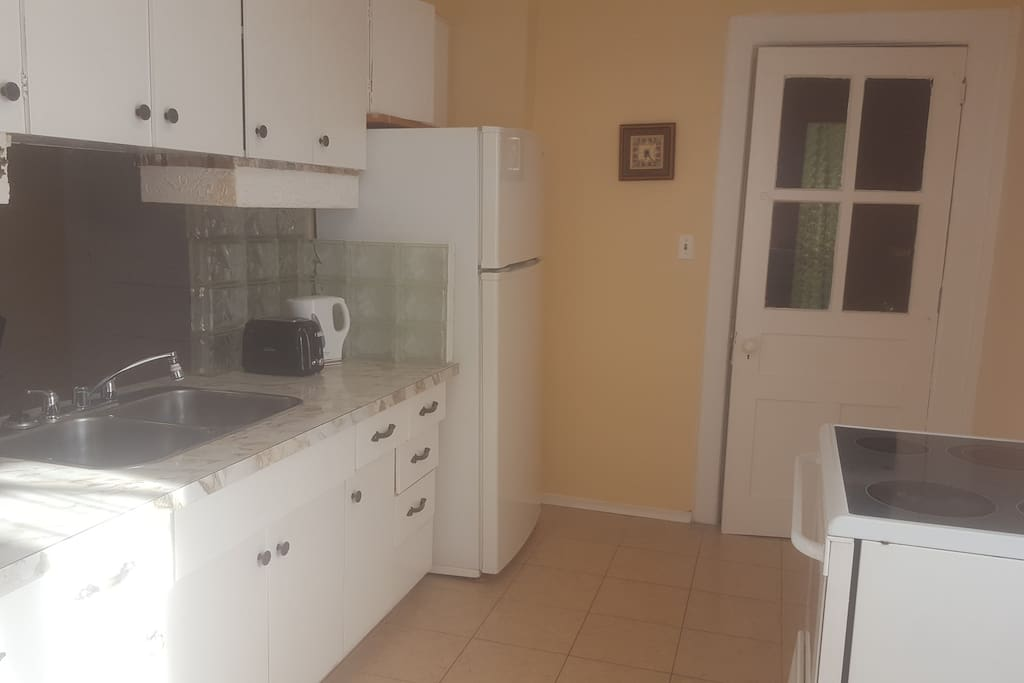 big and bright kitchen equipped with all amenities to make a gourmet meal