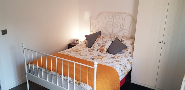Spacious double room with en-suite shower.