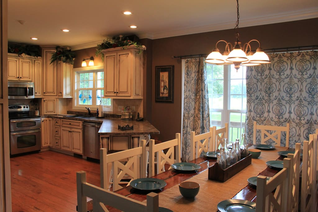 Main level- kitchen with farm table that seats 10 plus three person bar stool seating.