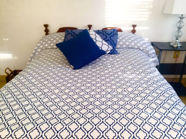 Room number 2 Is A 188sq foot room with tile floor One bedroom that is available. It is private, and has a  spacious mirrored closet with views of the Ocean Overlooking our spice and Herb gardens that You may Indulge in the use of Your  cooking
