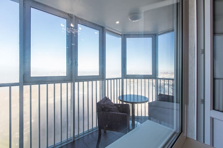 The balcony has panoramic windows that allow you to enjoy a beautiful view from the 25 (top) floor in the building. Its always great to enjoy a cup of tea or coffee while seating outside