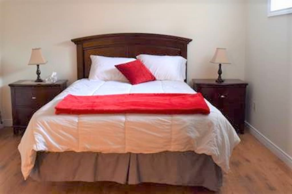 Queen size bed in 1st bedroom