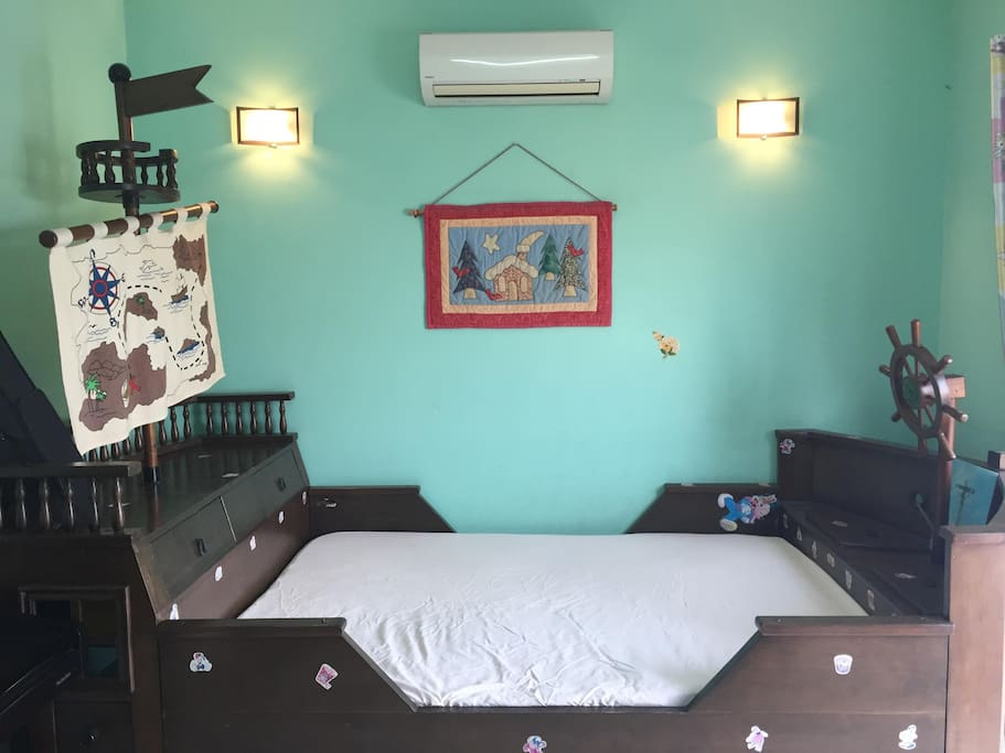 A. Double bed good for couple with AC & Fan