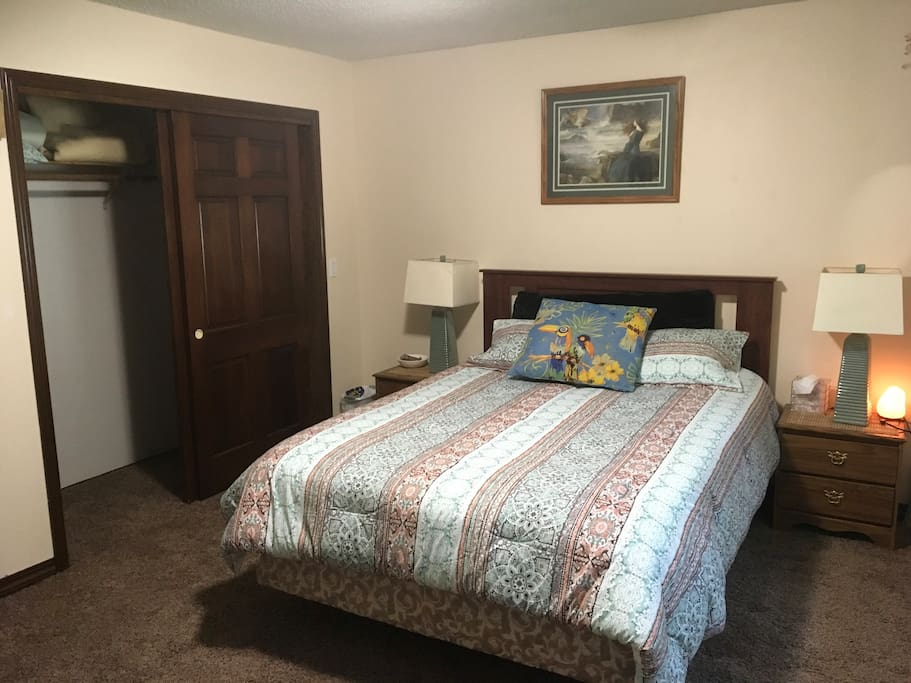 Full master bedroom with queen bed and large double closet.
