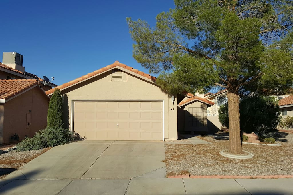 Quiet safe neighborhood with garage, full sized driveway, yard, and ample street parking