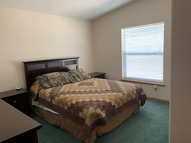3rd bedroom has a queen bed set with 2 night stands, a 6 drawer dresser with mirror, and a closet with hangers.