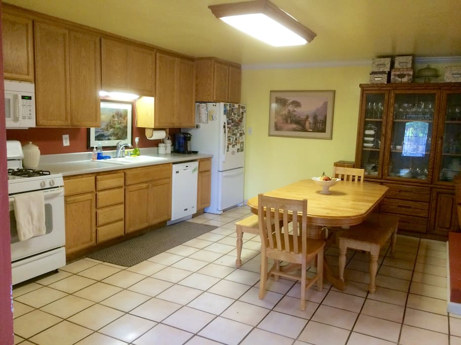 Kitchen with stove, oven, microwave, dishwasher, refrigerator (you get your own shelf), double sink, dining table and cupboards & drawers filled with anything you might need (dishes, cups, pots, pans, etc).