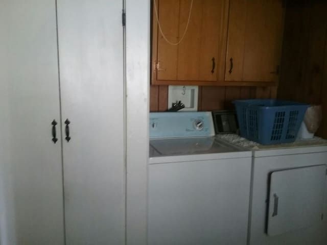 Washer, dryer and pantry closet off the kitchen.