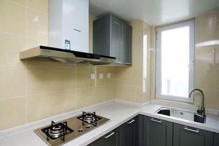 拜登观邸度假公寓(烟台马尔贝拉)高级海景单卧套房 - Yantai - Byt